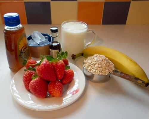Ingredients for a banana and strawberry breakfast smoothie