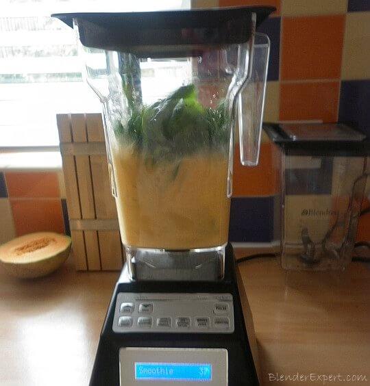 blending for a green melon smoothie
