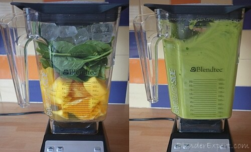 blending a mango and spinach smoothie