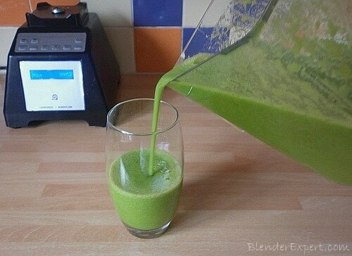pouring mango and spinach smoothie